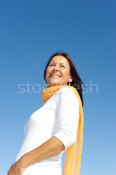 Relaxed mature woman sky background Stock photo © roboriginal