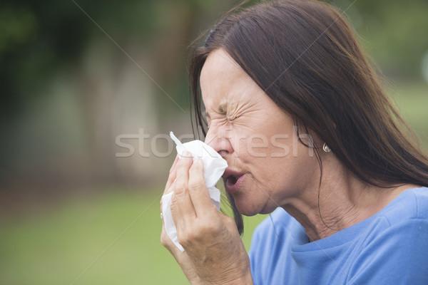 Sick mature woman suffering flu or hayfever Stock photo © roboriginal
