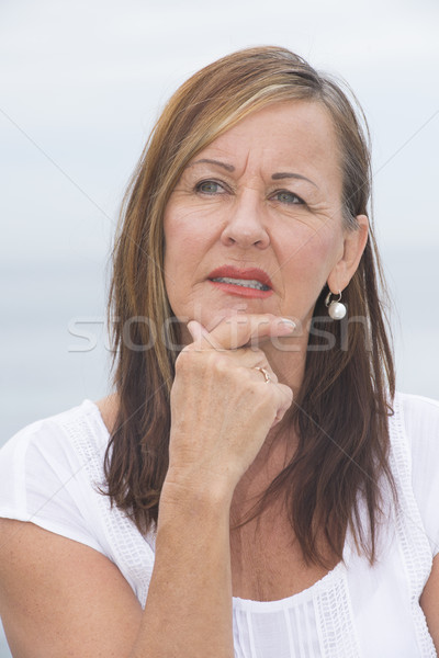 Concerned mature woman portrait outdoor Stock photo © roboriginal
