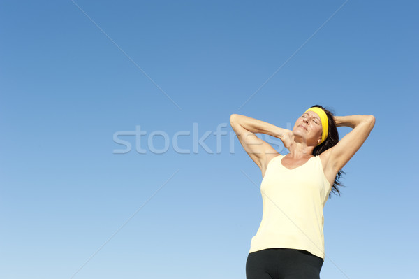 Active attractive mature woman isolated outdoor Stock photo © roboriginal