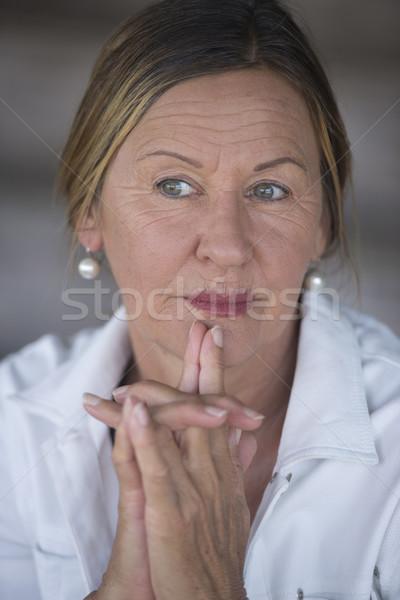 Thoughtful confident senior lady portrait Stock photo © roboriginal