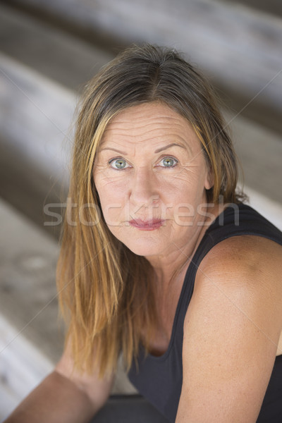 Lonely single mature woman upward look Stock photo © roboriginal
