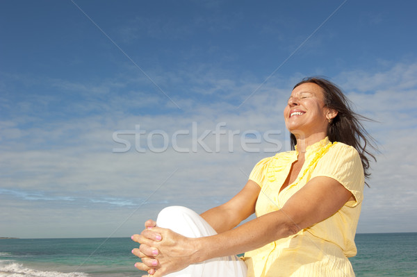 Cheerful mature woman ocean background Stock photo © roboriginal