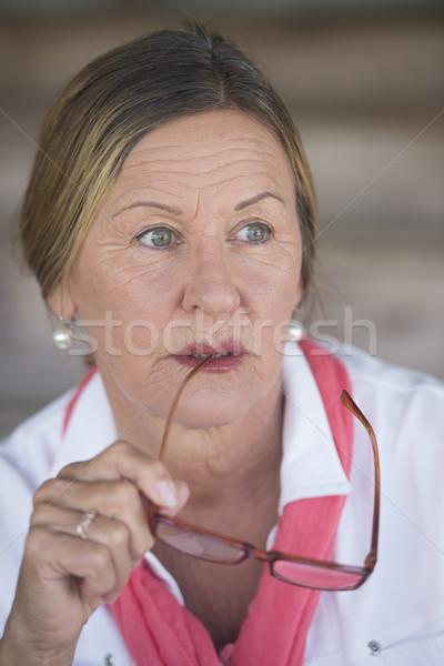 Thoughtful mature lady with glasses portrait Stock photo © roboriginal