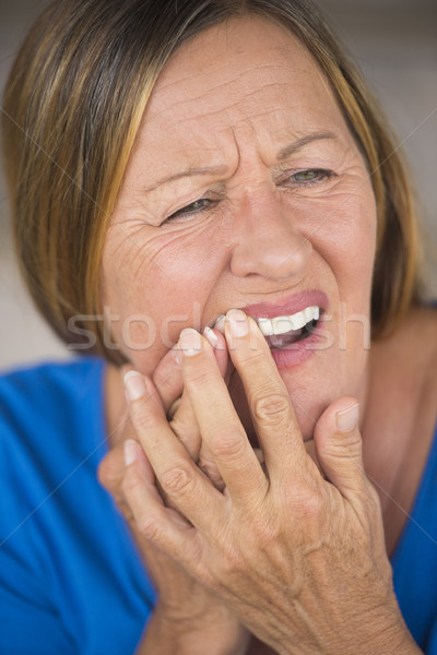 Woman with tooth ache in pain Stock photo © roboriginal