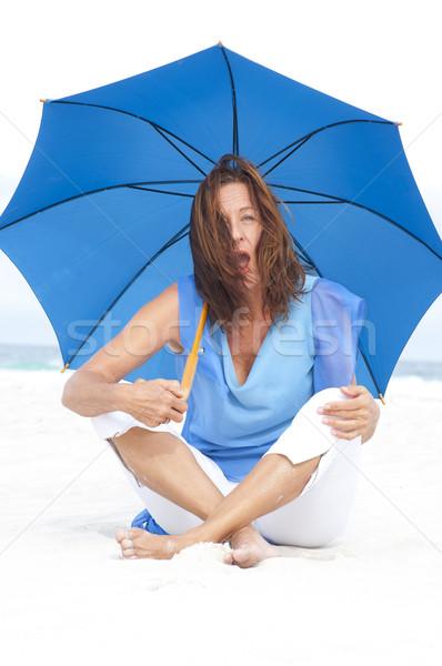 驚いた 成熟した女性 青 傘 ビーチ 肖像 ストックフォト © roboriginal