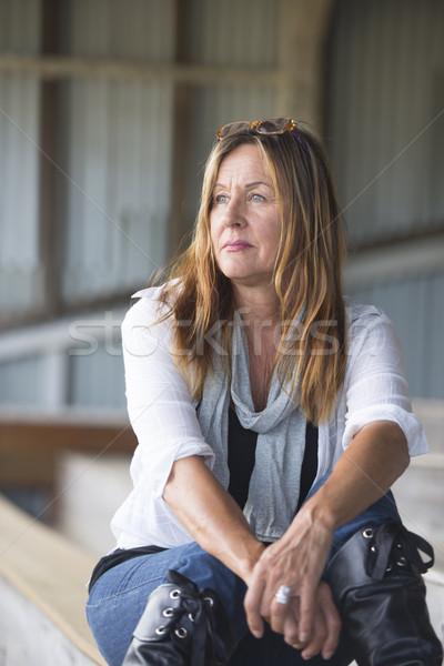 Attractive mature woman alone thoughtful Stock photo © roboriginal