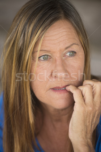 Stressed woman biting insecure finger nails Stock photo © roboriginal