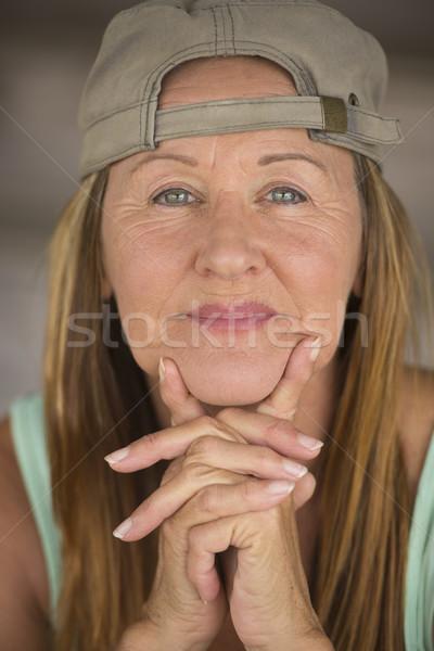 Active happy fit mature woman sporty cap Stock photo © roboriginal