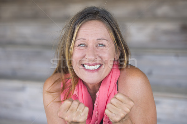 Happy Woman wishing luck fingers crossed Stock photo © roboriginal