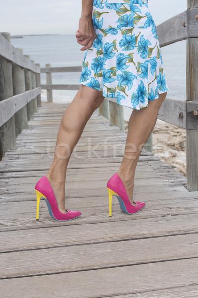 Mature woman in very high heel shoes outdoor Stock photo © roboriginal
