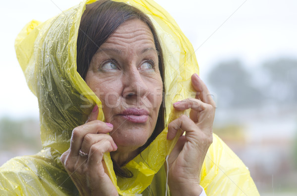 Mature woman rainy weather Stock photo © roboriginal