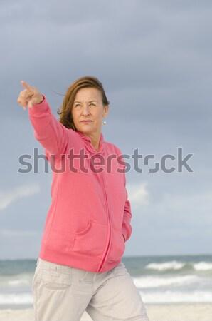 Senior woman meditating at beach Stock photo © roboriginal