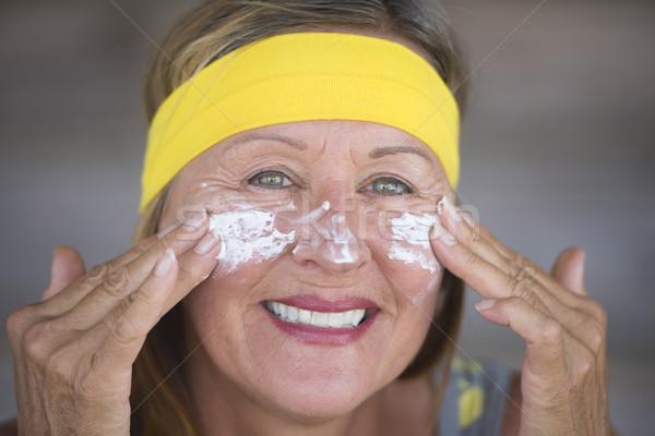 Skin care moisturiser joyful mature woman Stock photo © roboriginal