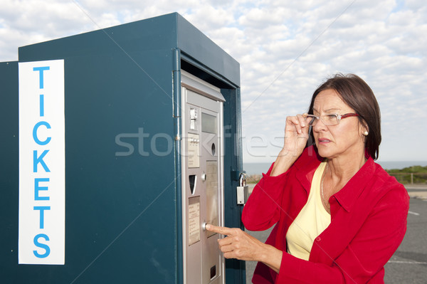 Woman at ticket machine Stock photo © roboriginal