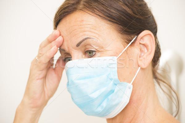 Bitkin tıbbi hemşire maske yüz portre Stok fotoğraf © roboriginal
