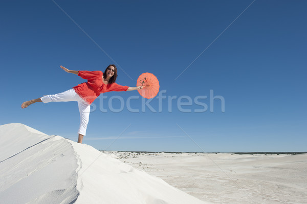 Beautiful mature woman balancing on sand dune Stock photo © roboriginal
