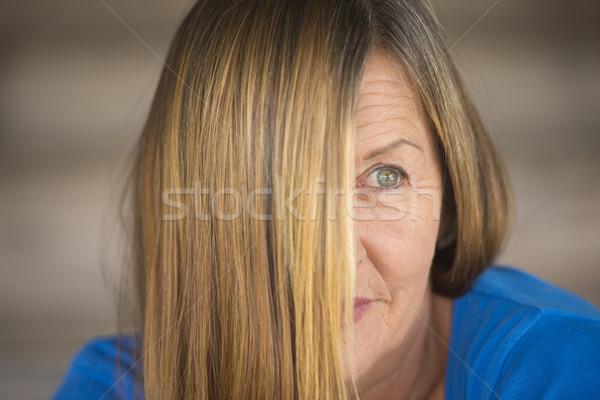 Mysterious woman hair covering face portrait Stock photo © roboriginal