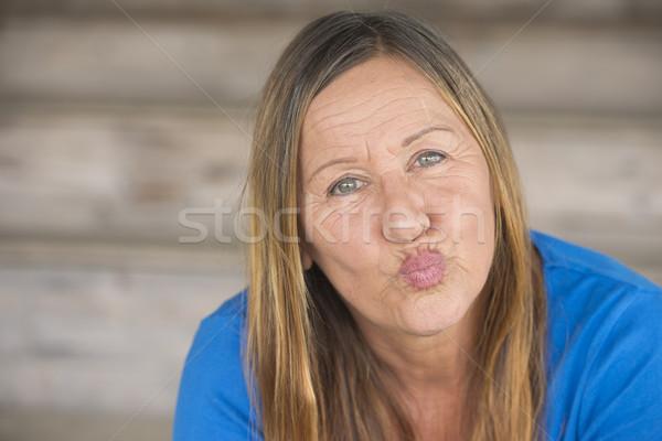 Portrait happy woman pursed lips Stock photo © roboriginal