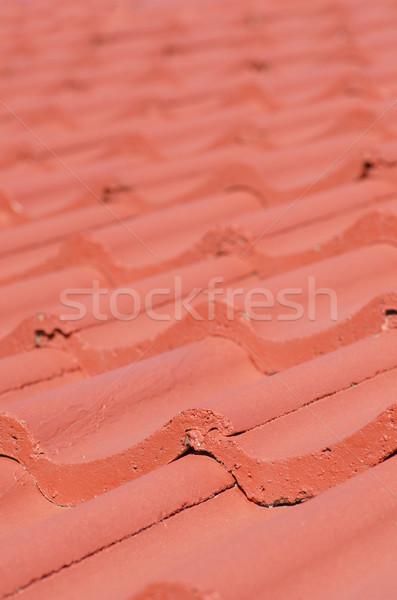Closeup red roof tiles blurred background Stock photo © roboriginal
