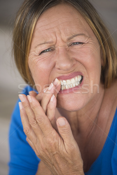 Woman in pain with tooth ache Stock photo © roboriginal