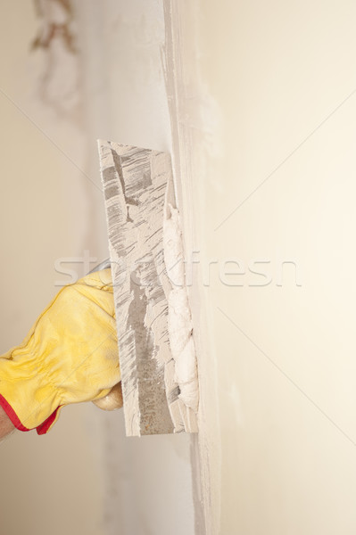 Home wall renovation with scraper and cement Stock photo © roboriginal