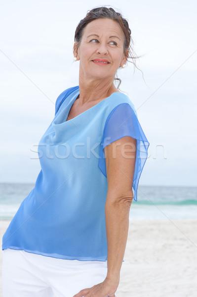 Portré érett nő kék blúz tengerpart gyönyörű Stock fotó © roboriginal
