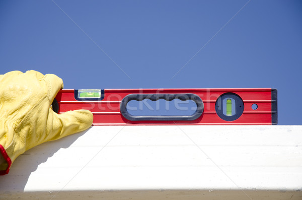 Hands with gloves on spirit level outdoor construction Stock photo © roboriginal