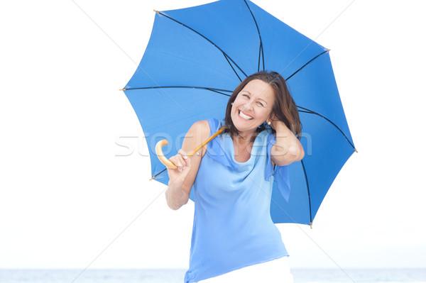 Stockfoto: Grappig · aantrekkelijk · rijpe · vrouw · Blauw · paraplu · portret