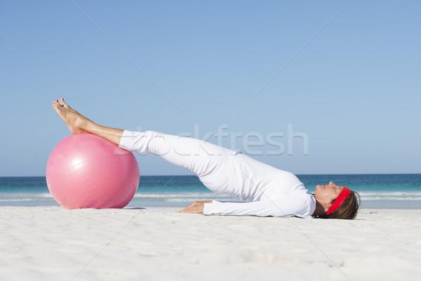 Mature woman sporty lifestyle beach Stock photo © roboriginal
