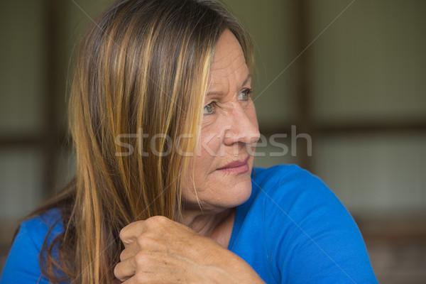 Thoughtful serious mature woman portrait Stock photo © roboriginal
