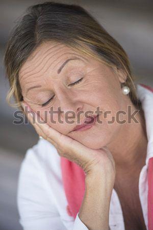 Sad contemplating mature woman resting in bed Stock photo © roboriginal