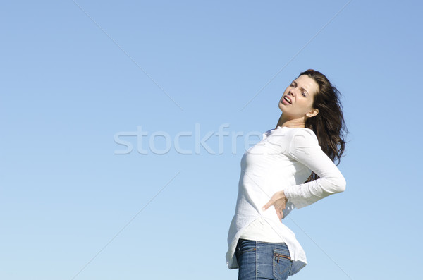 Young woman with back pain Stock photo © roboriginal