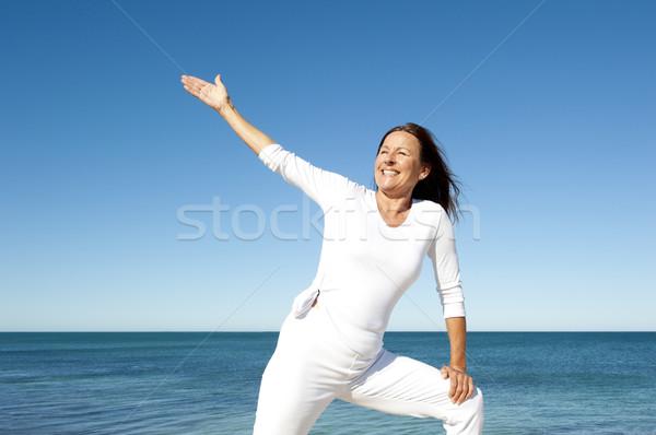 Confident mature woman ocean Stock photo © roboriginal