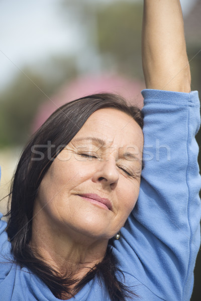 Portrait relaxed mature woman closed eyes Stock photo © roboriginal