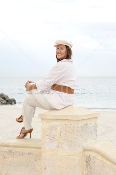 Attractive happy retired woman high heels holiday Stock photo © roboriginal