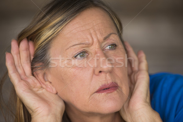 Woman listening curious to sound and noises Stock photo © roboriginal