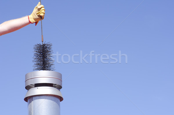 Cleaning chimney with sweeper sky background Stock photo © roboriginal