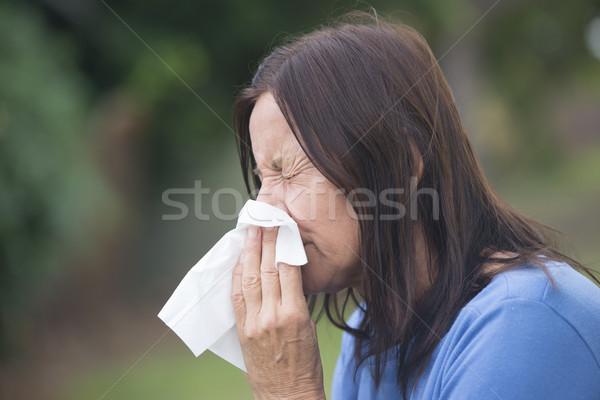 Nő szenvedés influenza papírzsebkendő portré vonzó Stock fotó © roboriginal