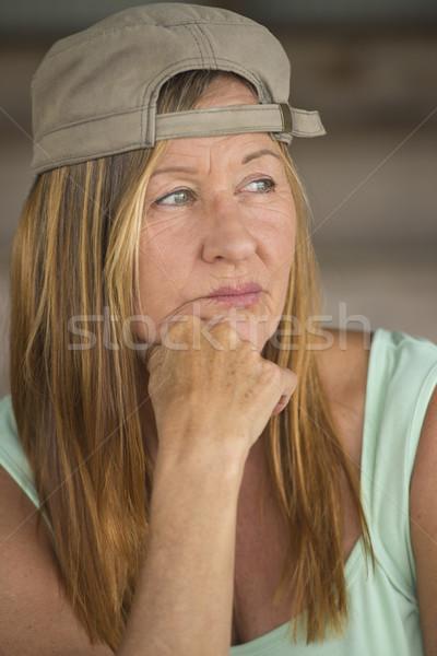 Thoughtful confident active woman with cap Stock photo © roboriginal