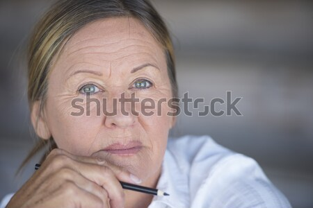 Attractive mature woman sad thoughtful Stock photo © roboriginal