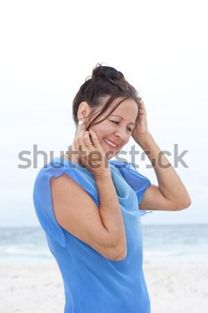 ストックフォト: 肖像 · 魅力的な · 成熟した女性 · 青 · ブラウス · 美しい