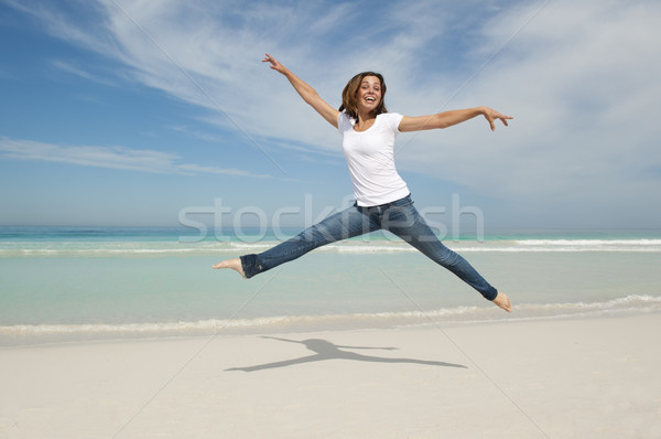 女性 ジャンプ 喜び ビーチ 幸せ ストックフォト © roboriginal