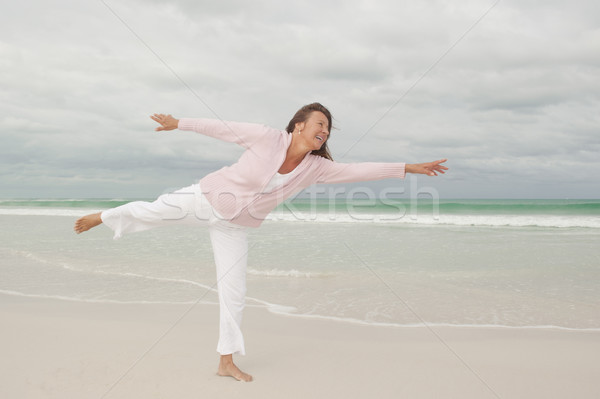Active happy senior woman beach isolated Stock photo © roboriginal