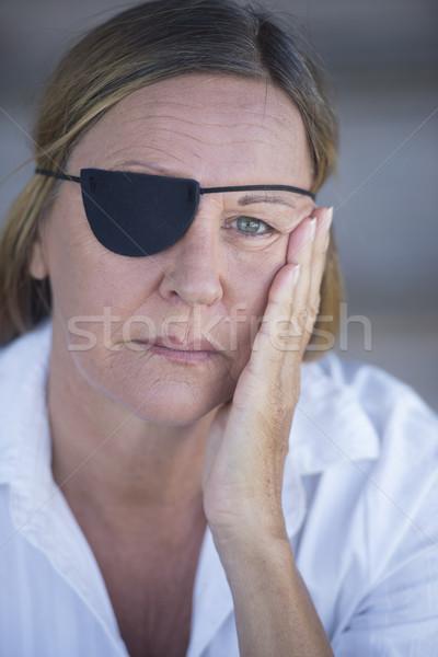 Stock photo: Sad woman with eye patch portrait