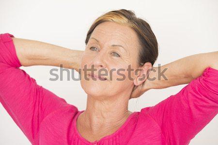 Relaxed senior woman daydreaming Stock photo © roboriginal