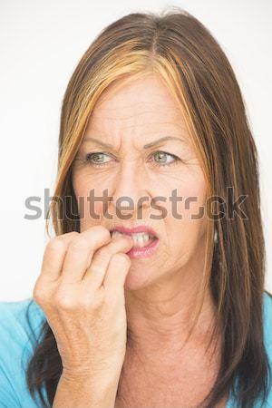 Woman biting nervous finger Stock photo © roboriginal