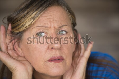 Insecure woman biting stressed finger nails Stock photo © roboriginal