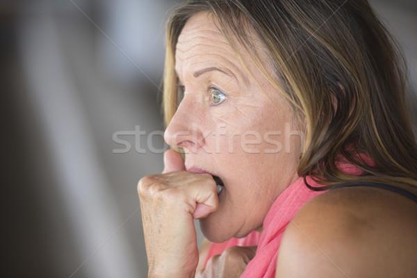 Shocked scared woman nail biting portrait Stock photo © roboriginal