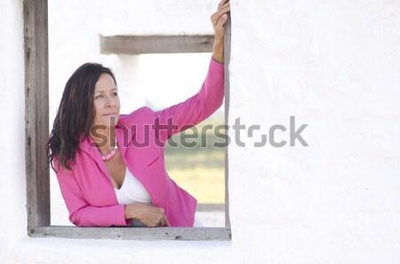 Boldog örömteli érett nő rózsaszín portré szexi Stock fotó © roboriginal